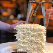 """<p></noscript>A slice of coconut cake at Ocean Prime is a great way to end your meal.</p> <p>""""><figcaption class="""