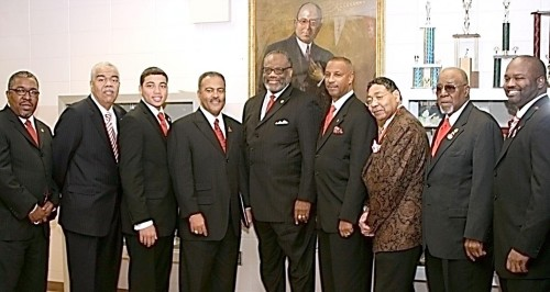 """Members of Kappa Alpha Psi Fraternity Inc. gather in front of a painting of one of their founding fathers, Elder Watson Diggs. Pictured left to right are members Richard L. Snow, executive director and chief operating officer; Michael J. Owens, Polemarch, North Central Province; Kristerpher J. Smith, Junior Grand Vice Polemarch; Dwayne M. Murray, Esq., Grand Polemarch; Eugene G. White, superintendent of Indianapolis Public Schools; Senior Grand Vice Polemarch William """"Randy"""" Bates Jr., Esq.; William G. Mays, president of Mays Chemical Co.; Arthur L. Carter Sr.; and Eugene L. Murray, Polemarch of the Indianapolis Alumni Chapter."""