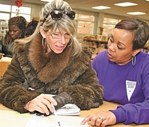 Maureen Nelson (left) seeks information from College Goal Sunday program coordinator Terri Cooley during the event, which provided students of all ages advice on obtaining state and federal grants.  (Photos/C. Guynn)