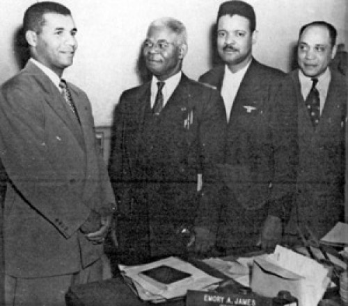 "<p>Roy Campanella (left), with Emory James, Wesley Jackson and<br /> Bibbs, visits Crispus Attucks High School. He visited at the<br /> invitation of Bibbs . (Courtesy of Phil S. Dixon)</p> <p>""><figcaption class="