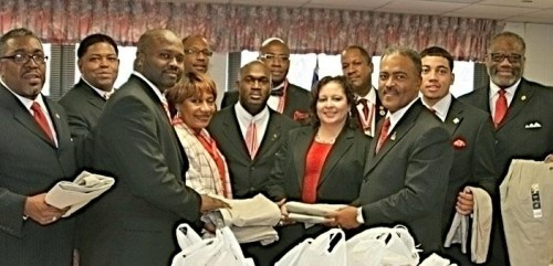 The Indianapolis Alumni Chapter donated school uniforms to the Kappa Closet at IPS #42. Pictured front row left to right: Snow; Eugene Murray; Deloris Sangster, principal of the school; Martin Hill; Jennifer Botts, the school's elementary director; Dwayne Murray; and White. Second row left to right: Kevin Adams; Bates; Lee Morgan; Chuck Carr Brown; and Smith. (Photos/L. Blaylock)
