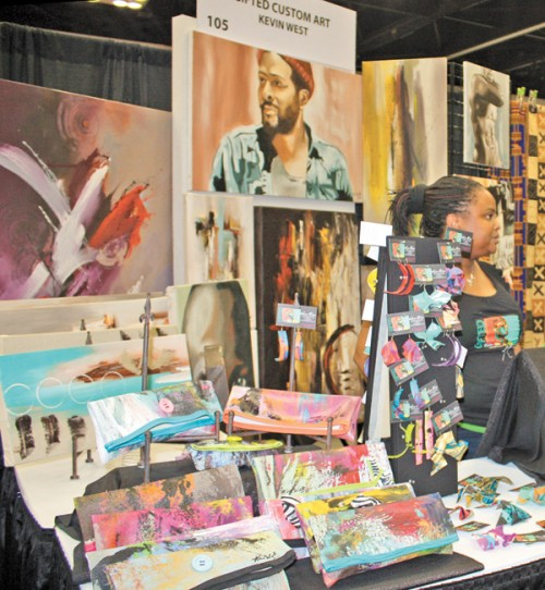 """<p>A Family member helps West sell Gifted art and accessories at<br /> Indiana Black Expo Summer Celebration. (Photos/Keshia Smith)</p> <p>""""><figcaption class="""