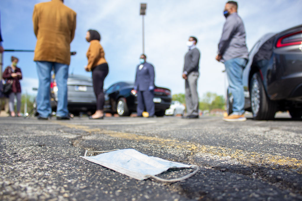 "<p>A face mask lay on the ground in an old Value City parking lot at the corner of 38th Street and Arlington Avenue, where city officials and community leaders asked residents to not participate in large gatherings. (Photo/Tyler Fenwick)</p> <p>""><figcaption class="