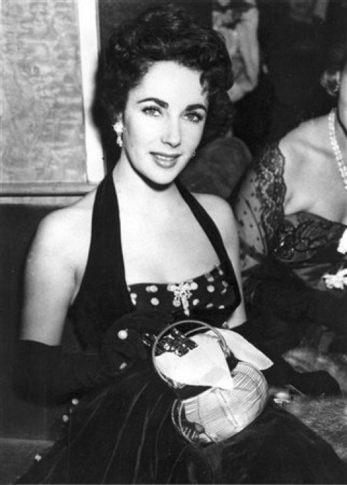 FILE - In a Sept. 22, 1951 file photo, Elizabeth Taylor is shown at the premiere of