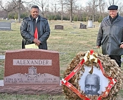 Phillip E. Burton (left) and Myron Hardiman pray at the gravesite. Kappa Alpha Psi was founded on the campus of Indiana University on Jan. 5, 1911.